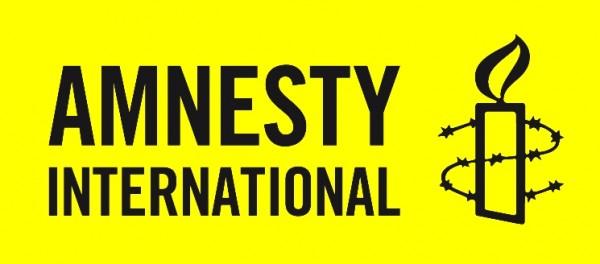Amnesty Inter_logo noir sur jaune.JPG